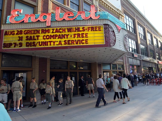 Guests wait outside the Englert Theatre for the start