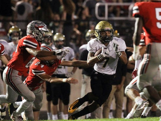 West High's Traevis Buchanan runs down field during