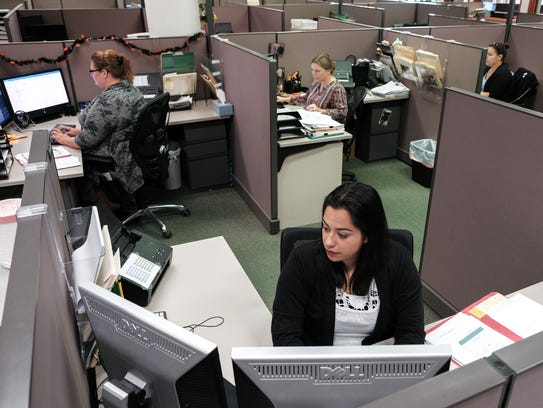 Financial Services of America personal concierge Melissa Diaz works at her desk.