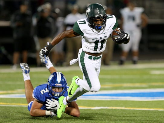 West Salem's Stanley Green (11) outruns McNary's Junior
