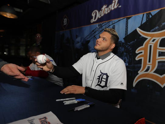 Tigers pitcher Joe Jimenez signs autographs during
