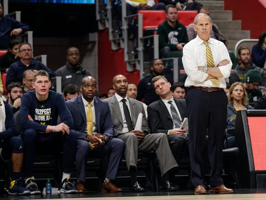 Michigan coach John Beilein, right, and (left to right)