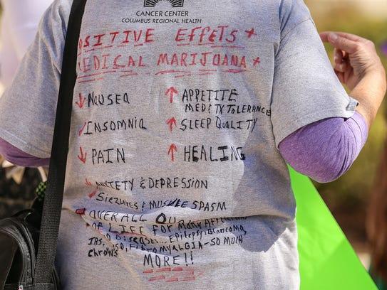 Registered nurse Colleen Larivee wears a T-shirt listing