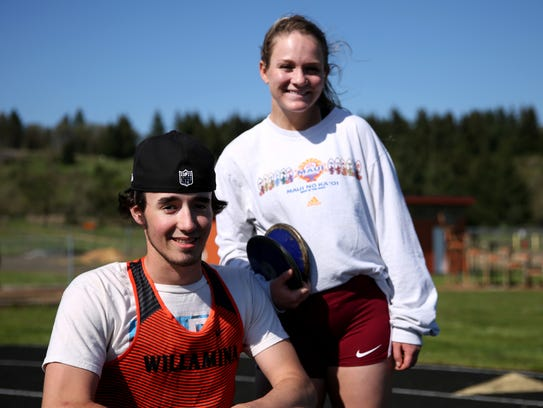 Owen Baker and his girlfriend Hannah Hughes, both juniors, smile for a photo during track practice at Willamina High School on April 26, 2018.