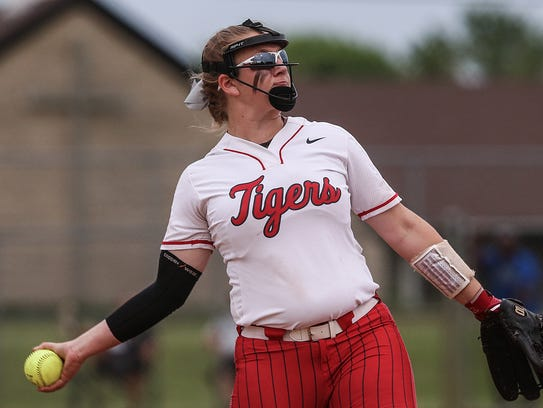 Fishers Tiger Hannah Mays (10) pitches during softball