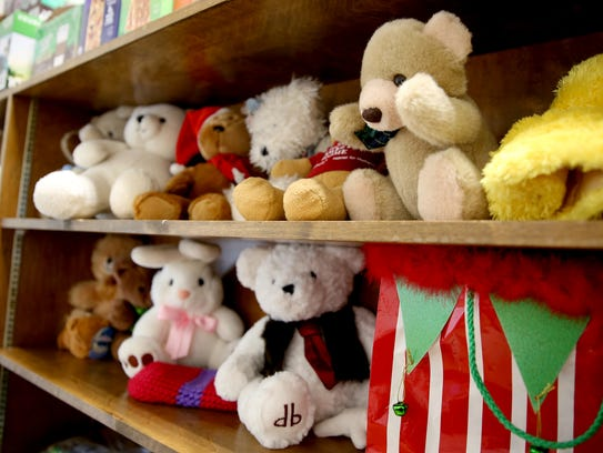 Stuffed animals wait for the hands of children at the