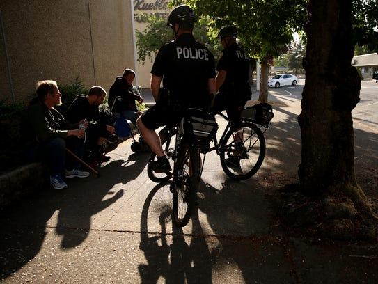 Salem Police Officers Andrew McFerron, center, and