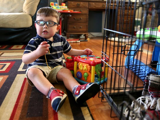 "Joseph ""Joey"" Shewey, 4, plays at his home in Aumsville,"