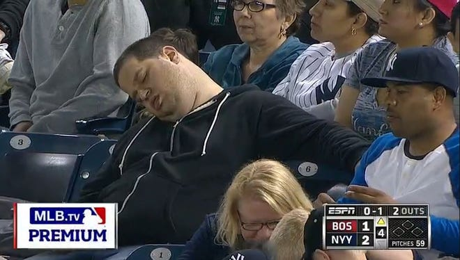 A screenshot from mlb.com showing Andrew Rector napping in the stands during an April 14 game against the Red Sox. He is suing the team, MLB and ESPN.