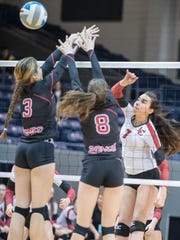 Churchill's Annabelle Dunn (right) goes on the attack against Romeo's Payton Klein (3) and Breanna Olley (8).