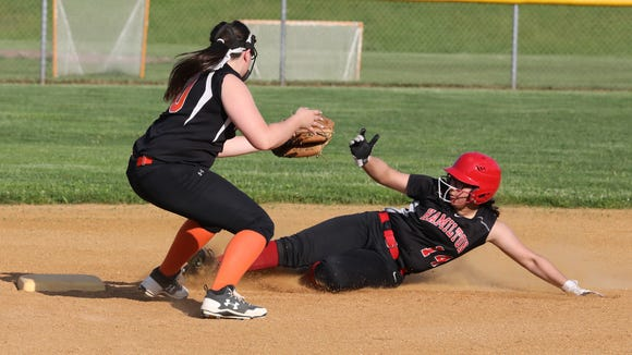Pawling's Allie Parent takes the throw as Hamilton's Lindsay Gonzalez steals second during the Section 1 Class C softball final at North Rockland May 25, 2018. Pawling won 27-0.