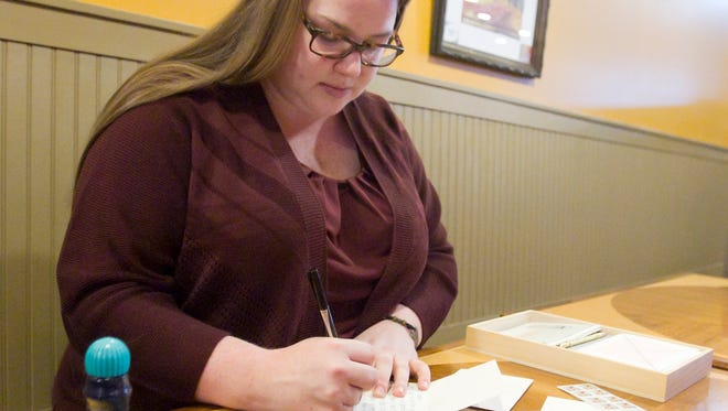 Candace Streng writes a thank-you note Friday, Nov. 17, 2017, to one of the financial supporters she's had to rely upon for her medical treatments in fighting aggressive cancer.