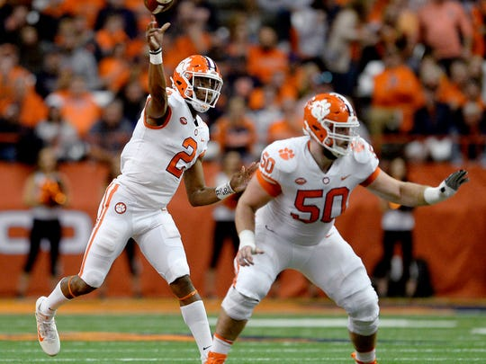 FILE - In this Oct. 13, 2017, file photo, Clemson quarterback Kelly Bryant (2) throws from the pocket behind the block of center Justin Falcinelli (50) during the first half of an NCAA college football game against Syracuse, in Syracuse, N.Y. Falcinelli was selected to the AP All-Conference ACC team announced Tuesday, Dec. 5, 2017. (AP Photo/Adrian Kraus, File)