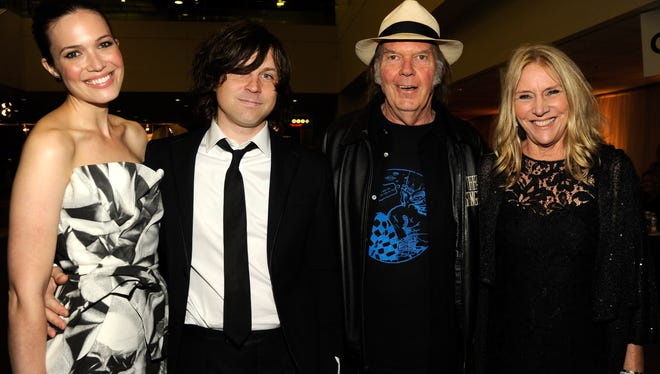 This photo contains two such examples. On the left, you have Mandy Moore and Ryan Adams, who announced their plans to divorce on Jan. 24. On the right, you have Rock and Rock Hall of Famer Neil Young, who filed papers to divorce Pegi, his wife of 36 years, in July 2014. They had two children and founded a school together.