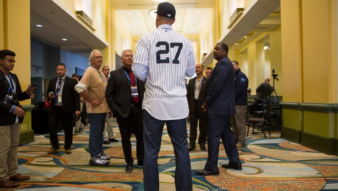 Newest Yankee Giancarlo Stanton with members of the media during the winter meetings in Orlando, Fla., on Monday.