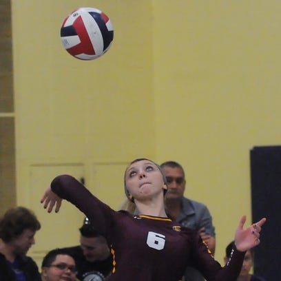 West Allis Central's Strom Olen serves in action from earlier this season.