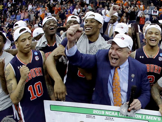 Auburn celebrates after beating Kentucky to earn a trip to the 2019 Final Four.