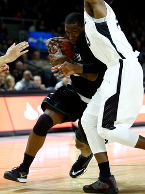 Binghamton's Jordan Reed drives to the basket against Providence Friars forward LaDontae Henton (right) during the second half at Dunkin' Donuts Center on Monday night.