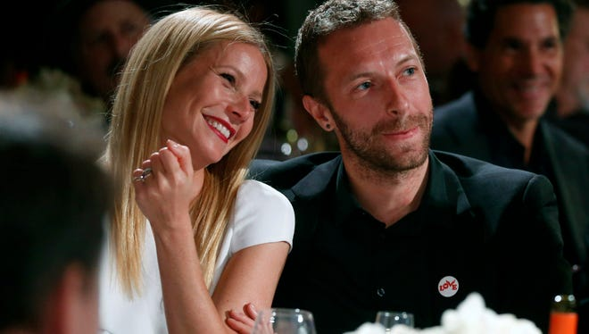 Actress Gwyneth Paltrow, left, and her husband, singer Chris Martin at the 3rd Annual Sean Penn & Friends Help Haiti Home Gala in Beverly Hills, Calif.