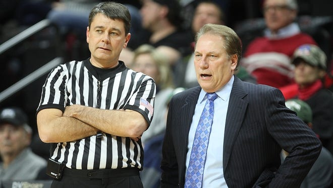 Michigan State basketball coach Tom Izzo speaks with a referee on the sidelines at Rutgers, Thursday.
