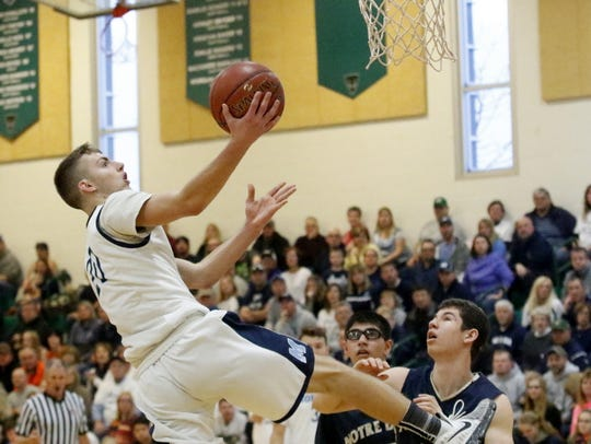 Moravia's Jordan Crossgrove goes up for a layup against