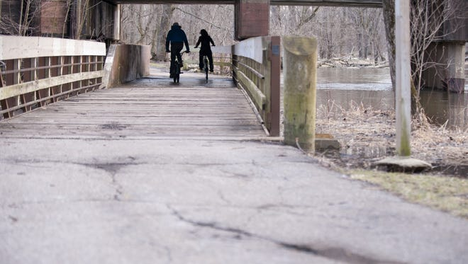 Police are searching for a man who stabbed at least one person Monday evening on the Lansing River Trail.