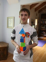 Daniel Rose-Levine with a collection of his cubes at