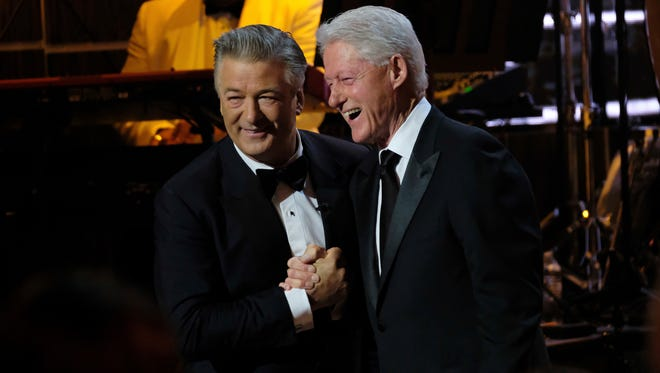 Alec Baldwin, left, and and former president Bill Clinton attend Spike TV's 'One Night Only: Alec Baldwin' at the Apollo Theater on Sunday, night in New York.
