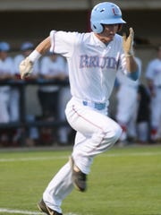 USJ's Cameron Tinker runs to first base Tuesday evening during a game against Tipton-Rosemark.