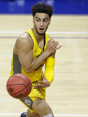 Marquette guard Markus Howard dishes out an assist.