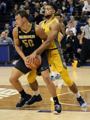 Marquette's Theo John plays some tight defense on UWM's Brett Prahl during the teams' charity exhibition scrimmage.