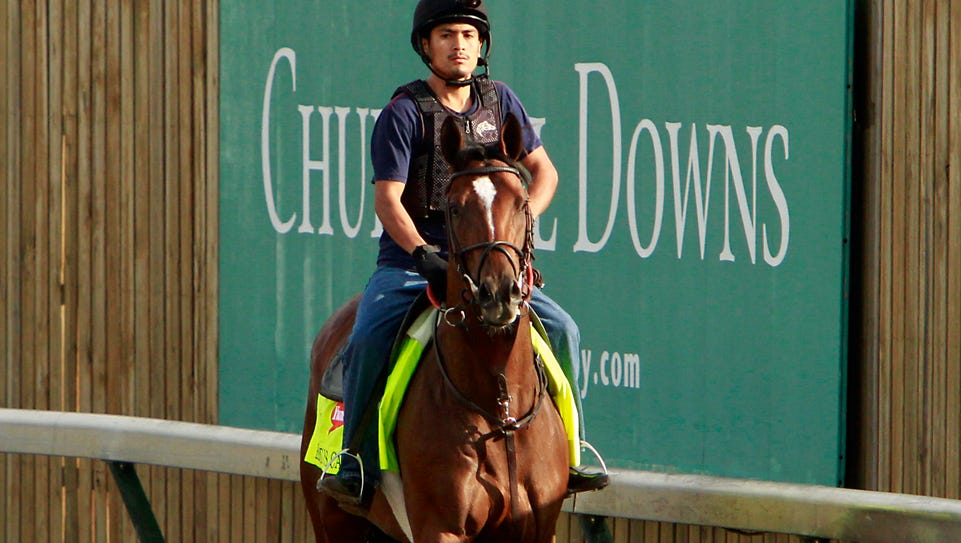 Exercise rider Miguel Garcia walks Kentucky Derby hopeful