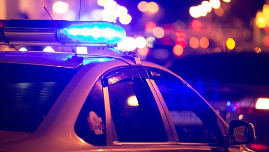 A stock image of police lights at night.