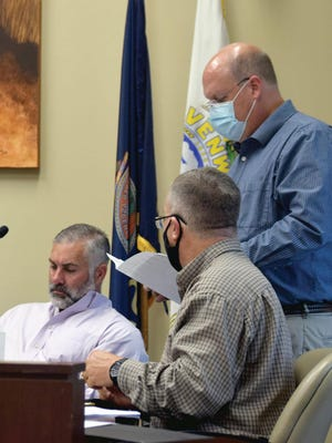 County Administrator Mark Loughry, right, speaks with Commissioners Chad Schimke and Mike Stieben on Tuesday during a budget meeting.