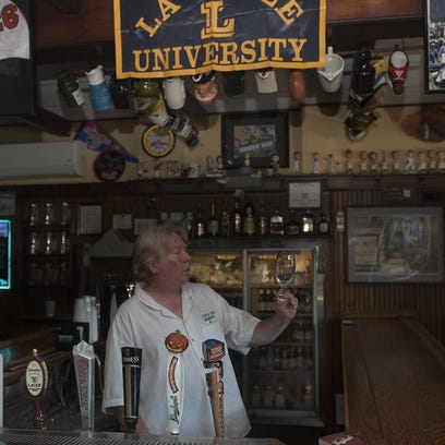 Tim O'Malley,  a bartender at the Oaklyn Manor, cleans