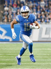 Golden Tate runs after a catch during the second quarter against the Packers at Ford Field on Dec 31, 2017.