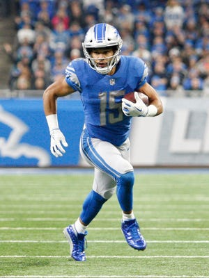 Lions receiver Golden Tate runs after a catch during the second quarter against the Packers at Ford Field on Sunday, Dec 31, 2017.