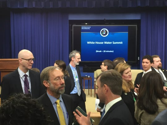 Participants chat during a break at the White House Water Summit on Tuesday.