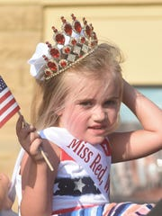 A participant in the 2018 Red, White & Blue parade adjusts her crown during last year's event. This year's parade is schedule to begin at 5:30 p.m. in downtown Mountain Home.