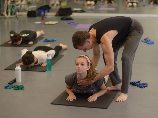 Tom Welsh works with dancers in the FSU Dance Science program.