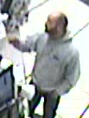Irondequoit police believe that the man in this surveillance photo is responsible for two separate robberies. This photo is from the earlier incident.