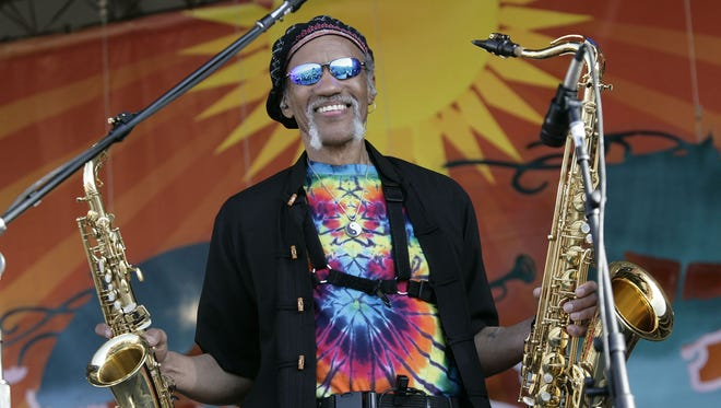 In a May 4, 2008 file photo, Charles Neville arrives with The Neville Brothers on stage to perform during the 2008 New Orleans Jazz & Heritage Festival. The saxophonist has died at age 79.