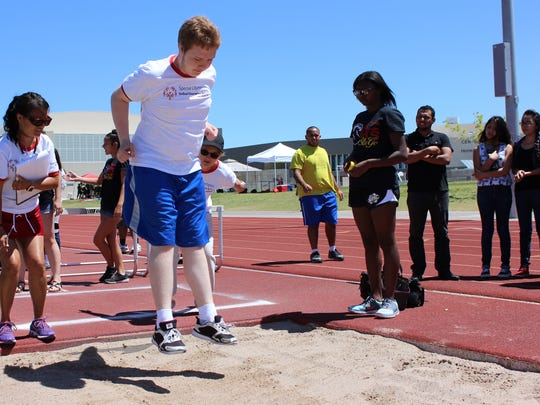 Centennial High School student Nicky Larsson competes in the standing long jump at Centennial High School on Wednesday, May 17, 2017.