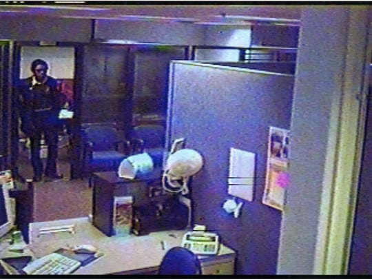 A security camera photo of the perpetrator in the 2003 robbery of the Xerox credit union in Webster.
