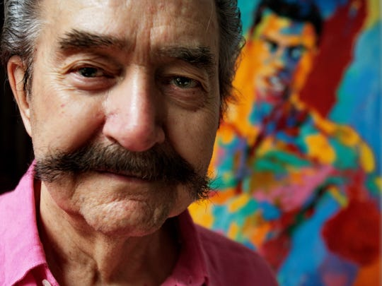 In this Aug. 31, 2007, file photo, artist LeRoy Neiman poses in his studio in New York.