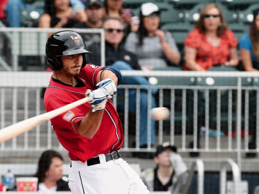 Chihuahuas first baseman Tommy Medica watches as the pitch makes its way to the plate and his bat during the game against the Tacoma Rainiers Sunday afternoon.