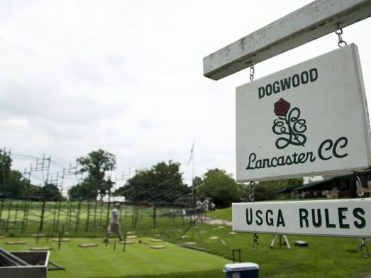 Crews assemble the grandstand behind the 18th green at the Lancaster Country Club as crews prepare the course for the 2015 U.S. Women's Open, which will be held at the club July 9-12, 2015.