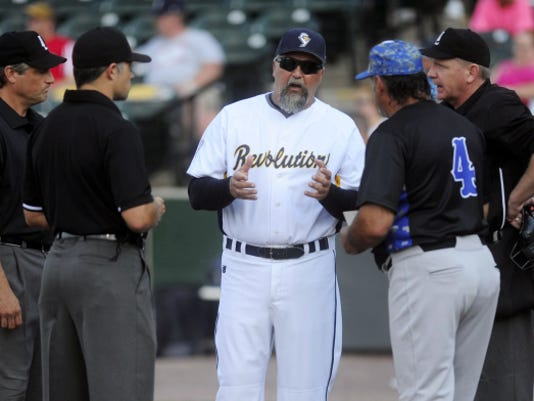 York Revolution manager Mark Mason talks with umpires prior to the Revs' home game against Sugar Land on June 29. Injuries have hit the Revs hard in 2015, forcing Mason to change his lineup card often.