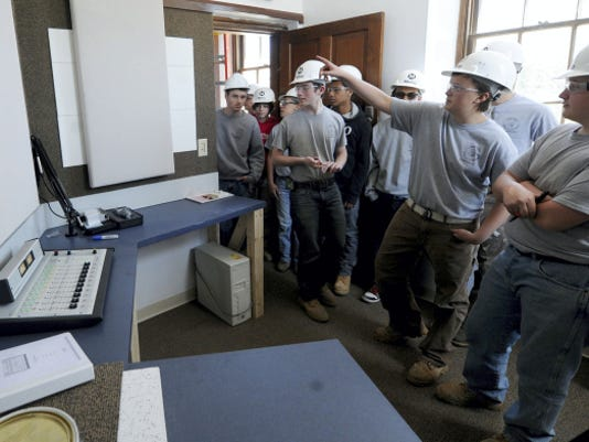Students from York County School of Technology look in on the finished radio station they helped build at First St. John Lutheran Church in York.