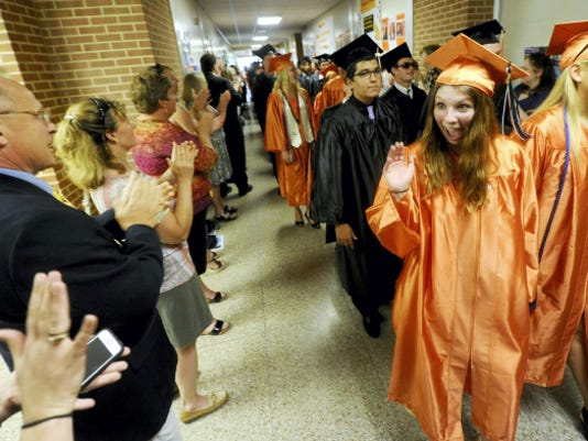 Northeastern High School senior Katlyn Rode waves to the staff at Northeastern School District who came to say good by to the students before the graduation ceremony held  on Saturday.